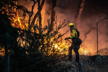 Firefighters near a home in Santa Rosa, California, fight flames from the Glass fire.