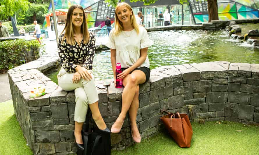 Ines Teixeira (left) and Holly White take a lunch break together in Canary Wharf