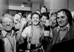 British featherweight boxing champion Pat Cowdell celebrates with some of his fans after defeating challenger Jimmy Flint at the Royal Albert Hall in February 1980. Cowdell retained his title after Flint retired in the 11th round.