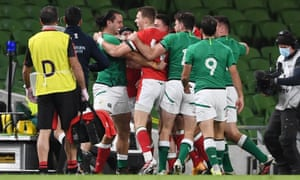 Tempers boil over between James Lowe of Ireland and Liam Williams of Wales.
