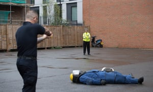 The Metropolitan Police Commissioner, Cressida Dick, watches police officers carry out Taser training in London