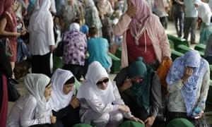 Bosnian Muslim women in Potocari near Srebrenica in tears over coffins.