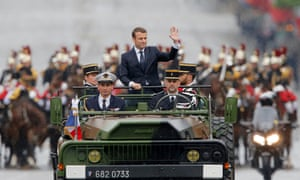 Macron rides in a military vehicle on the Champs Élysées after his inauguration on 14 May.