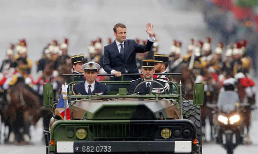 Emmanuel Macron rides in a military vehicle on the Champs-Élysées following his official inauguration in 2017