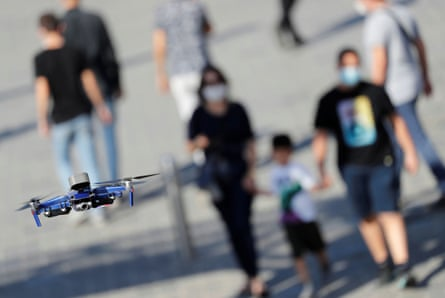 A police drone fitted with a megaphone speaker patrols over Taksim Square in Istanbul searching for people not wearing face masks.