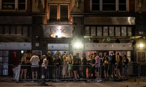 London, UK: people queue outside Fabric as nightclubs reopened and mask-wearing rules have been relaxed
