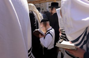 Jerusalem. Worshippers recite the Priestly Blessing on the holiday of Passover in front of the Western Wall