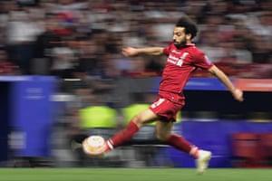 Liverpool's Mohamed Salah runs for the ball.