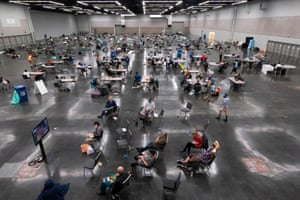 Oregon, US: Portland residents fill a 'cooling center' to escape temperatures exceeding 40C.