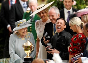 Frankie Dettori stands next to the Gold Cup trophy at Royal Ascot as Queen Elizabeth looks on