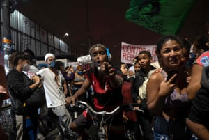 People protest against a police operation to find drug traffickers in the Jacarezinho favela in Rio de Janeiro