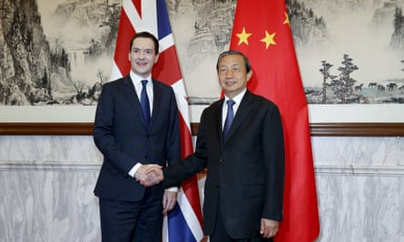 Chinese Vice Premier Ma Kai shakes hands with Britain's Chancellor of the Exchequer Osborne before the start of the 7th China-UK strategic economic dialogue at Diaoyutai State Guesthouse, in Beijing