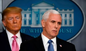 Donald Trump stands behind Mike Pence as he speaks at a news conference at the White House in Washington DC, on 26 February.