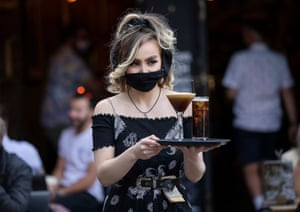 Cardiff, WalesA waitress serves customers after bars and restaurants re-opened in South Wales as coronavirus restrictions are eased allowing outdoor hospitality to reopen.