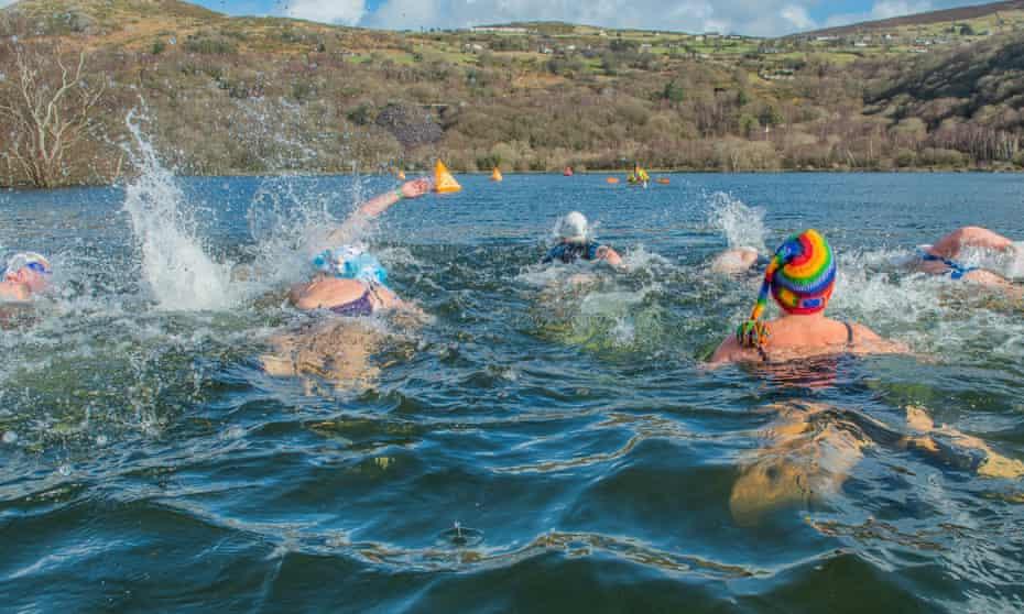 Swimmers in water for Welsh Winter Swim Love Swim Run, UK.