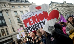 Protesters against period poverty at the London Women's march, January 2019