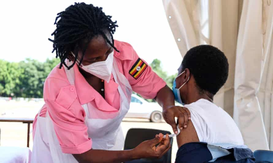 A nurse injects a Covid-19 vaccine at Kololo Ceremonial Grounds in Kampala, Uganda, on 31 May.