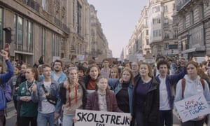 Thunberg with Belgian campaigners on a school climate strike in Brussels in 2019.