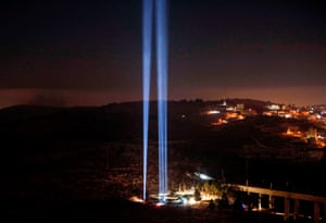A light show in tribute to New York City on the eve of the 18th anniversary of the 11 September 2001 attacks, at the 9/11 living memorial plaza on a hill overlooking Jerusalem.