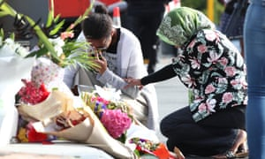 Locals lay flowers in tribute to those killed and injured at Deans Avenue near Al Noor Mosque
