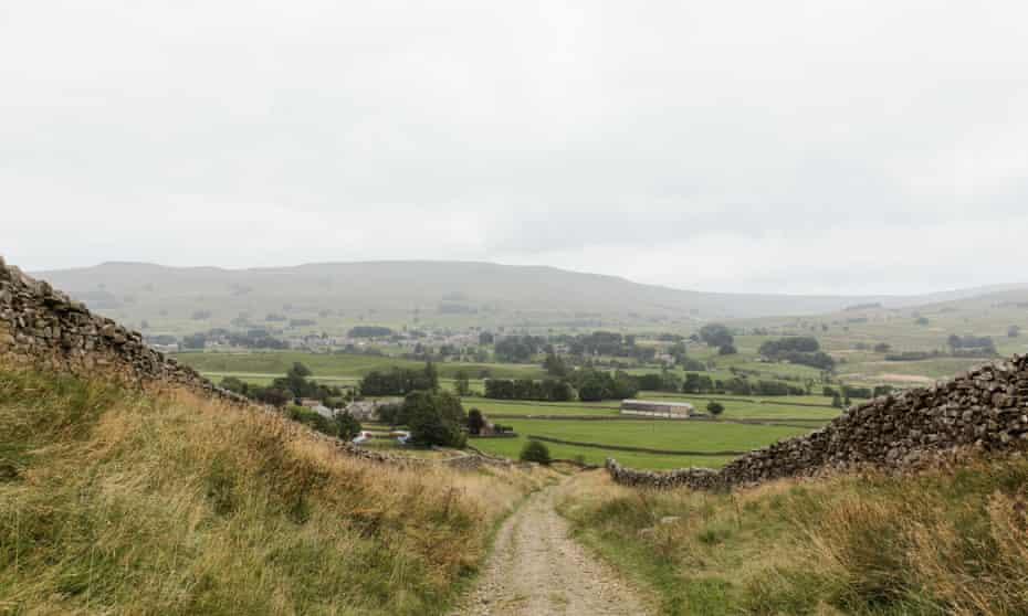 Walking down from Great Shunner Fell, with Wether Fell in the distance.