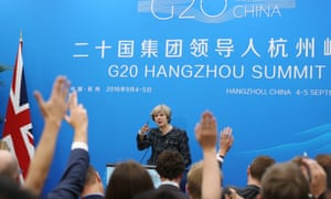 Theresa May gestures at her press conference after the G20 Summit at the Hangzhou International Expo Centre in Hangzhou, China.