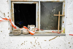 Schuld, GermanyA cross leans against a window next to muddy crockery outside a house damaged by the floods that caused the deaths of at least 180 people