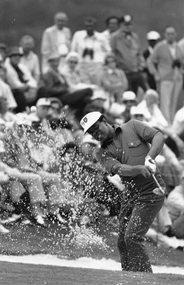 Lee Elder hits the ball from a sand trap on the 18th hole at the 1975 Masters in Augusta.