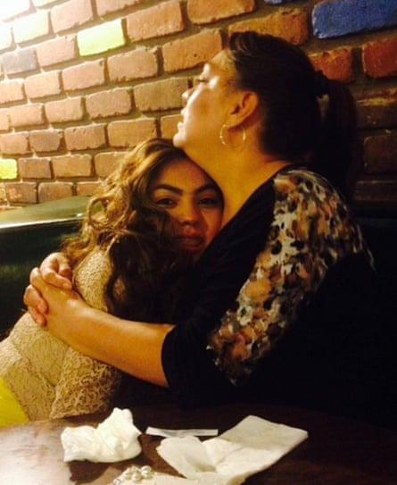 Mendoza holds her older daughter, Lisette Mendoza, circa 2015.