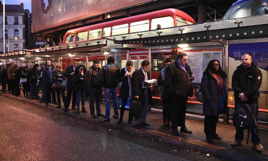 Commuters queue at Victoria bus station during a tube strike on 9 January