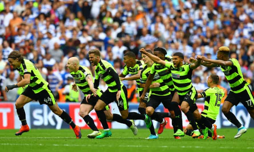 Huddersfield Town celebrate victory in their Premier League promotion play-off against Reading in May.