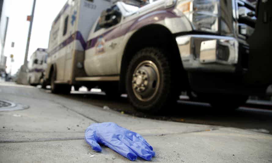 Discarded examination gloves are seen next to an ambulance by NYU Langone Hospital.