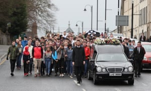 The cortege arrives at St Patrick's church for the funeral of Morgan Barnard.