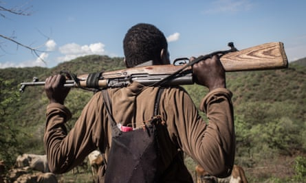 A Tungen herder watches over his livestock with an illegal rifle in Baringo County, Kenya. At least 530,000 small arms are estimated to be in circulation among civilians.