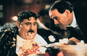 Terry Jones as Mr Creosote with John Cleese.