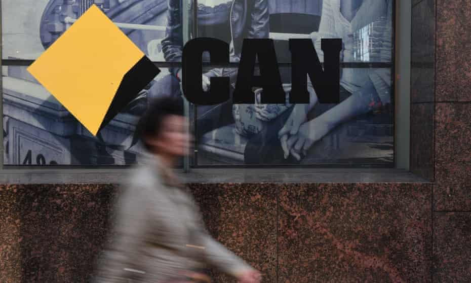 CBD workers walk past a Commonwealth Bank