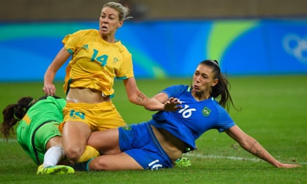 Brazil's Beatriz slides into a challenge with Australia's Lydia Williams and Alanna Kennedy