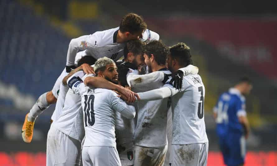 Italy players celebrate Domenico Berardi's goal in Sarajevo.