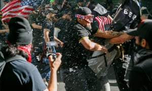 Street fighting in Portland, with men in 'Proud Boys' uniform to the fore.