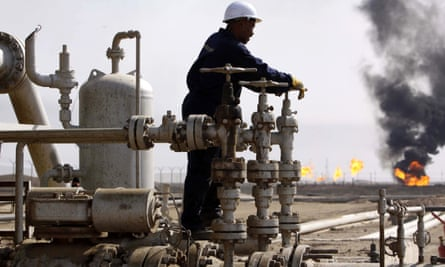 A worker operates valves at the Rumaila oil refinery, near Basra, Iraq.