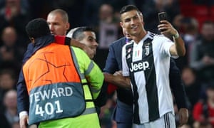 Cristiano Ronaldo takes a selfie with a pitch invader after the game.