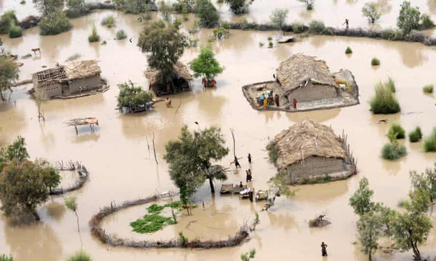 Residents in a flood-affected area on the outskirts of Sukkur in Pakistan