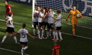 Sara Däbritz of Germany celebrates with teammates after opening the scoring.