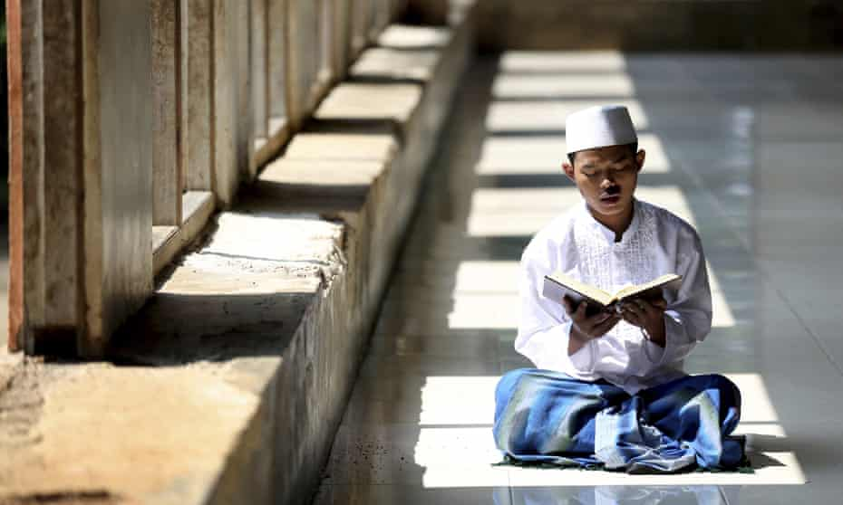 A student reads the Quran at the Al-Ashriyyah Nurul Iman Islamic boarding school in Indonesia, the largest Muslim-majority country.