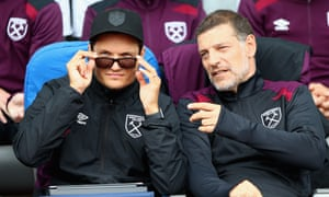 Slaven Bilic, right, speaks to the first-team coach, Edin Terzic, during the pre-season friendly against Manchester City in Reykjavik.