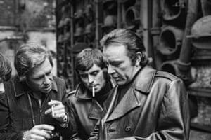Ian McShane (Wolfe Lissner), Richard Burton (Vic Dakin) filming on location at Nine Elms gas works