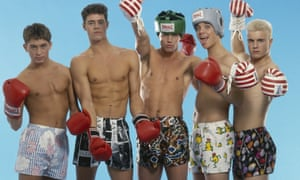 Take That English boy band Take That pose in boxer shorts and red boxing gloves, as worn in their first video 'Do What You Like', 1991. From left to right, Mark Owen, Howard Donald, Jason Orange, Robbie Williams and Gary Barlow.