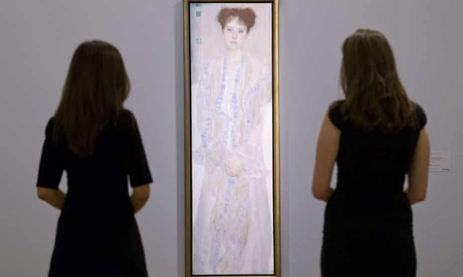 Two employees of Sotheby's auction house pose by Klimt's Portrait of Gertrud Loew.