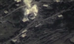 An aerial image from Russia's defence ministry shows air strike on a militant base in the province of Latakia, Syria.