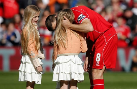 Steven Gerrard kisses one of his daughters before his final game at Anfield